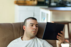Man Reading a Tablet Computer Stock Photography