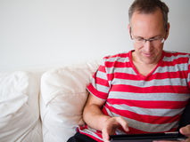 Man reading on a tablet Stock Photos