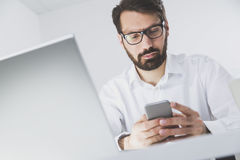 Man reading a text message on his phone Stock Photo