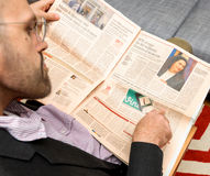 Man reading about Twitter selling Vine solcial network Stock Images