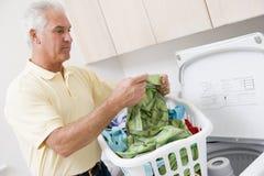 Man Reading Washing Instructions Stock Image