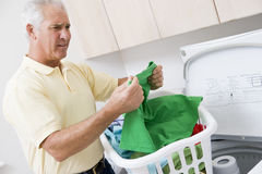 Man Reading Washing Instructions Stock Photos