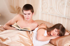 Man reading and  woman sleeping Royalty Free Stock Photo