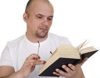 The man reads the bible Stock Photo