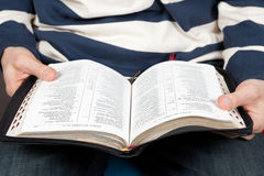 A man reads the Bible Stock Photo
