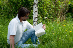 A man reads a book Stock Image