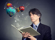 A man reads a book Royalty Free Stock Photo