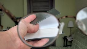 A man reads a book, a first-person view. 4k stock video footage