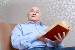 Man reads a book at home Stock Images
