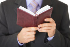 Man reads entries in notebook - close-up Stock Image