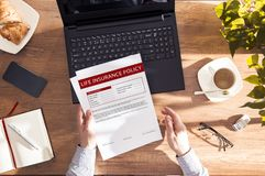 Man reads life insurance agreement. royalty free stock image