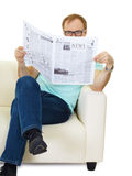 Man reads the news in the newspaper Royalty Free Stock Images
