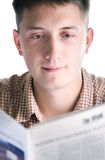 Man reads newspaper. Young man reads newspaper. Close up Stock Photo