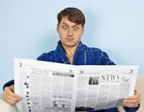 Man reads a newspaper with a admiration Royalty Free Stock Photo