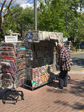 Man reads newspaper headlines. ATHENS, GREECE - APRIL 23, 2017: Man reads Sunday newspaper headlines at outdoors newsstand Stock Image