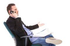 Man reads newspaper phoning - economy news Stock Photos