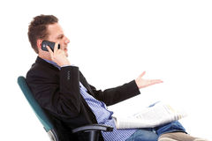 Man reads newspaper phoning - economy news Royalty Free Stock Photography