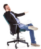 Man reads newspaper phoning - economy news Stock Photography