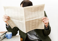 The man reads the newspaper Stock Photo