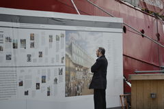Man Reads About NYC Seaport at Museum Royalty Free Stock Image