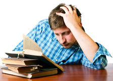 Man reads old book at the table Stock Photos