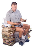 Man reads on the toilet. Sitting man reads on the toilet Royalty Free Stock Photography