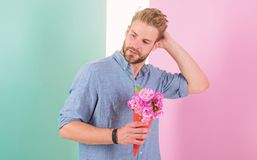 Man ready for date bring pink flowers. Boyfriend confident holds bouquet waiting for date. Guy bring romantic pleasant. Gift waiting for her. Best flowers for royalty free stock image