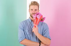 Man ready for date bring pink flowers. Guy bring romantic pleasant gift waiting for her. Best flowers for her. Boyfriend. Confident holds bouquet waiting for royalty free stock image