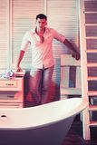 Man ready for having bath at bathroom to refresh.  stock photography