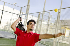 Man ready for hit ball in paddle tennis court Royalty Free Stock Photography