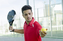 Man ready for paddle tennis serve Royalty Free Stock Photo