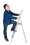 Man ready to climb a ladder Royalty Free Stock Images
