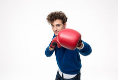 Man ready to fight with boxing gloves. Business man ready to fight with boxing gloves royalty free stock image