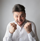 Man ready to fight. Prepared businessman readty to start a fight Stock Photos