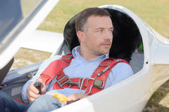 Man ready to fly inside cockpit glider Stock Image