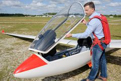 Man ready to fly ultralight propeller-driven airplane. Man ready to fly an ultralight propeller-driven airplane Stock Images