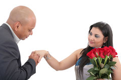 Man ready to give a kiss in hand to his wife. Royalty Free Stock Photography