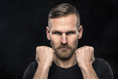 Man ready to hit with his fists Stock Images