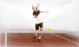 Man is ready to hit tennis ball. Strong man is ready to hit tennis ball Royalty Free Stock Image