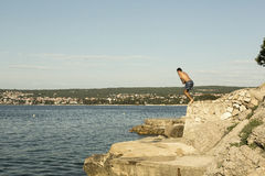 Man ready to jump in to the sea royalty free stock images