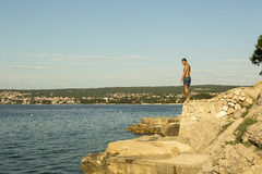 Man ready to jump in to the sea royalty free stock photo
