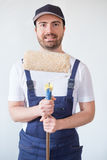 Man ready to paint one wall holding painting tools Royalty Free Stock Image