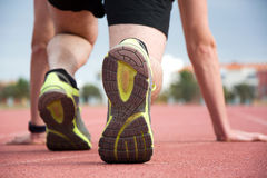 Man ready to run on the running track Royalty Free Stock Images