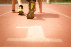 Man ready to run on the track Royalty Free Stock Photos
