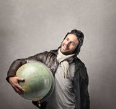 Man ready to travel. Young man ready to travel holding a globe stock photography