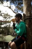 Man ready to zip line in adventure park. On a sunny day Royalty Free Stock Image