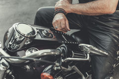 Man ready for trip on motorbike Stock Image