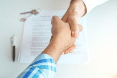 Man with real estate agent in the agency office. Man with real estate agent rent apartment handshake Stock Photo