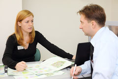 Man and realtor discuss architectural design of apartment Royalty Free Stock Image