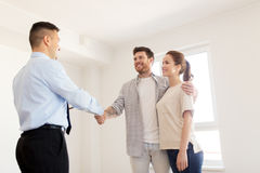 Man and realtor shaking hands at new home Stock Photography